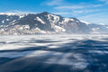 Frozen lake Zeller and snowy mountains in Austria Royalty Free Stock Photo