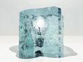 Frozen light bulb in ice Stock Images