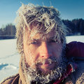 Frozen man close up portrait of the young with icy hairs on head and beard Royalty Free Stock Photography