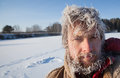 Frozen man portrait of the young with icy hairs on head and beard Stock Image