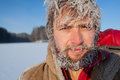 Frozen man portrait of the young with icy hairs on head and beard Royalty Free Stock Photos