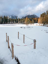 Frozen nove strbske pleso high tatras winter view of closed wooden pier at surface of lake tarn covered with snow and peaks in Royalty Free Stock Photo