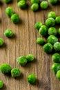 Frozen peas organic baby sweet on wood board Stock Photos