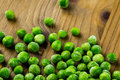Frozen peas organic baby sweet on wood board Stock Photography