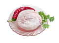 Frozen pork, chili pepper and cilantro sprig on glass dish Royalty Free Stock Photo