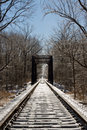 Frozen Railroad Tracks and Trestle Bridge Stock Photo