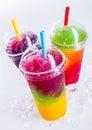 Frozen Rainbow Slush Drinks Chilling on Ice Royalty Free Stock Photo