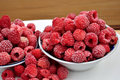Frozen raspberries in a bowl Royalty Free Stock Photo