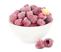 Frozen raspberries in a saucer isolated on white background Royalty Free Stock Photography