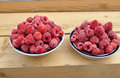 Frozen raspberries on table Royalty Free Stock Photo