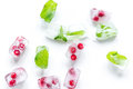Frozen red berries in ice cubes on white background top view Royalty Free Stock Photo
