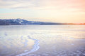 Frozen River and distant mountains Royalty Free Stock Photo