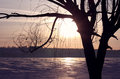 Frozen river at sunset Stock Photography