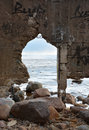 Frozen sea through the arch and moody sky Royalty Free Stock Photos