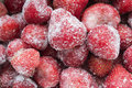 Frozen strawberries a lot of as a background Royalty Free Stock Photography
