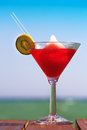 Frozen Strawberry Daiquiri cocktail on the wooden pier. Concept Royalty Free Stock Photo