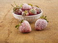 Frozen strawberry on a wooden table Royalty Free Stock Photos