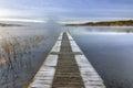 Frozen swedish bridge in october month idyllic foggy landscape of lake autumn season Royalty Free Stock Photo