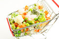 Frozen vegetables mixture of carrots peas broccoli green beans brussels sprouts cauliflower are shopping carts with ice and snow Stock Photography