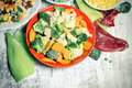 Frozen vegetables in plate and bowl Royalty Free Stock Photo