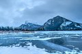 Frozen vermilion lakes banff national park lake in with mt rundle in the background just before sunrise Stock Photography