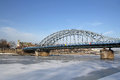 Frozen vistula river and bridge in krakow poland at sunny day Stock Photo