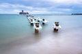 Frozen wooden breakwaters line to the world war II torpedo platform at Baltic Sea Royalty Free Stock Photo