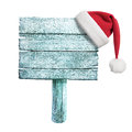 Frozen wooden sign with red santa s hat isolated on white Stock Images