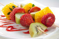 Fruit allsorts on skewers Stock Photos