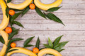Fruit background wood with bananas and tangerines corner Stock Images
