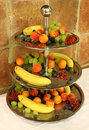 Fruit bowl full of ripe fruits Stock Images