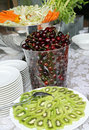 Fruit buffet mixed with kiwi green and red cherries Royalty Free Stock Photo