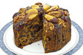Fruit cake rich decorated with nuts and cherries Royalty Free Stock Image