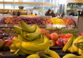 Fruit department in supermarket with bananas in the foreground Stock Images