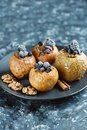 Fruit dessert baked apples stuffed with blackberry, blueberries, cinnamon, nuts, honey. Royalty Free Stock Photo