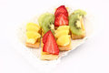 Fruit dessert of kiwi, pineapple and strawberries Royalty Free Stock Photo