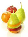 Fruit dressage pear dressed in pieces of different fruits next to them Stock Photo
