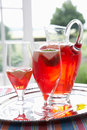 Fruit drink in a decanter and glasses Royalty Free Stock Image