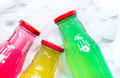 Fruit drinks in colorful plastic bottles with ice top view mock-up Royalty Free Stock Photo