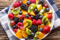 Fruit fresh mixed tropical fruit salad. Bowl of healthy fresh fruit salad - died and fitness concept Royalty Free Stock Photo