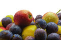Fruit freshly picked apple, plum, cherry plum with water drops Royalty Free Stock Photo