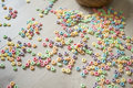 Fruit froot loops spilled on floor Royalty Free Stock Photo