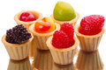 Fruit gelatin figures and tartlets Royalty Free Stock Photo