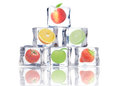 Fruit in ice cubes fresh frozen inside over a white background Royalty Free Stock Photo