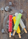 Fruit ice pops on old wood background Stock Image