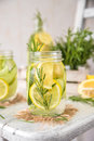 Fruit Infused Detox Water with lemon, cucumber and rosemary Royalty Free Stock Photo