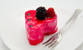 Fruit jelly cake and fork on the plate isolated Royalty Free Stock Photo
