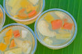 Fruit jelly small cup on green banana leaf Stock Images