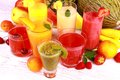 Fruit juice with kiwi apricot cherry watermelon tangerine and pear top view Royalty Free Stock Images