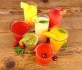 Fruit juices, kiwi, raspberries, cherry, orange, strawberry and pineapple Royalty Free Stock Photo